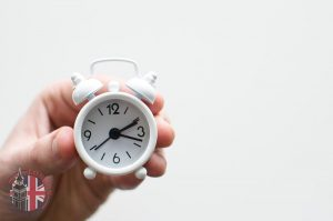 Hand holding a tiny clock